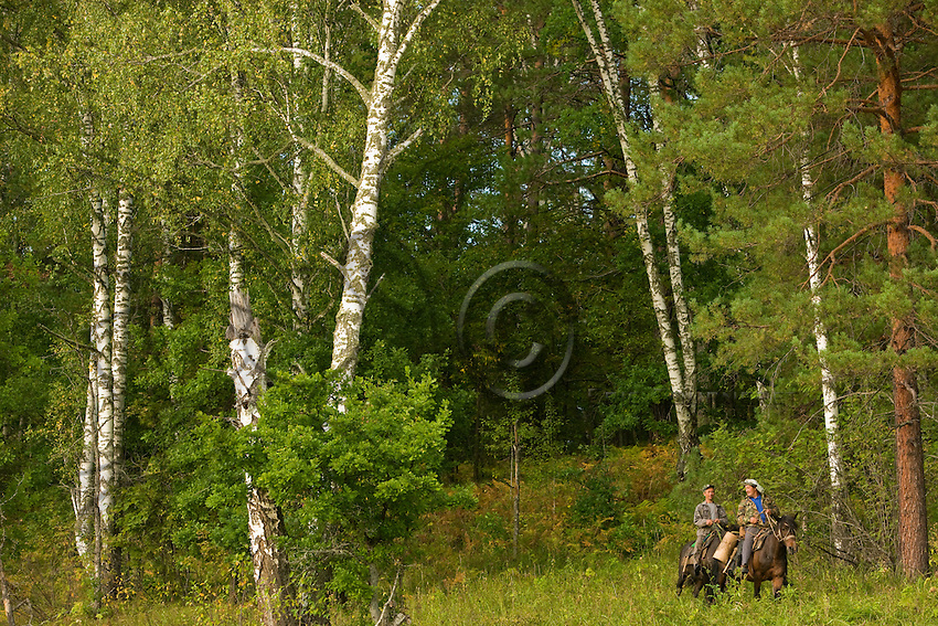 Alkar Isanomatov and Issangugin Sentimir, forest wardens and beekeepers, leave on horseback to harvest their bortyes on behalf of the reserve.