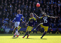 Pictured: Pablo Hernandez of Swansea (C) looks on as team mate Wayne Routledge heads the ball away. Sunday 16 February 2014<br /> Re: FA Cup, Everton v Swansea City FC at Goodison Park, Liverpool, UK.