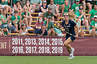 NEWTON, MA - MAY 22: Diana Kelly #12 of Notre Dame brings the ball forward during NCAA Division I Women's Lacrosse Tournament quarterfinal round game between Notre Dame and Boston College at Newton Campus Lacrosse Field on May 22, 2021 in Newton, Massachusetts.