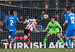 Goalkeeper Damian Emiliano Martinez of Getafe CF  (R) reaches for the ball after an attempt at goal by Jorge Molina Vidal of Getafe CF (C) in action during the La Liga 2017-18 match between Getafe CF and Athletic Club at Coliseum Alfonso Perez on 19 January 2018 in Madrid, Spain. Photo by Diego Gonzalez / Power Sport Images