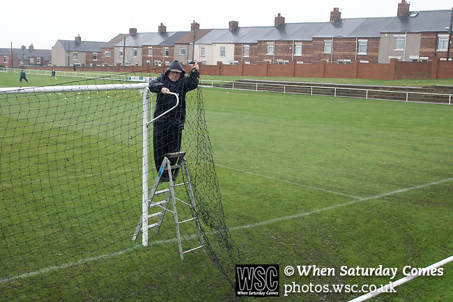Horden Colliery Welfare 0 Billingham Synthonia 2, 24/10/2009. Welfare Park, Northern League Division One. A groundsman putting up the goal nets prior to the Northern League division one fixture between Horden Colliery Welfare (red) and Billingham Synthonia, at Welfare Park, Horden. Horden won division two in the previous season but lost this fixture 2-0 against their higher-placed opponents. Photo by Colin McPherson.