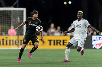 FOXBOROUGH, MA - AUGUST 4: Lee Nguyen #24 of Los Angeles FC controls the ball as Wilfried Zahibo #23 of New England Revolution closes during a game between Los Angeles FC and New England Revolution at Gillette Stadium on August 3, 2019 in Foxborough, Massachusetts.