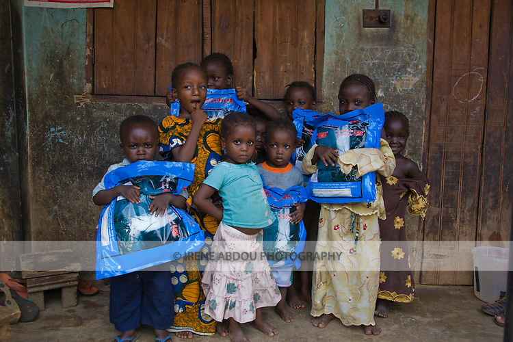 Children hold Permanet long lasting insecticide treated mosquito nets in the Garki area of Abuja, Nigeria.  Permanet is manufactured by Vestergaard-Frandsen and distributed in Nigeria by the Society for Family Health (SFH).  SFH is Nigeria's largest indigenous NGO and affiliate of the international NGO, Population Services International.