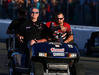 Jul. 26, 2013; Sonoma, CA, USA: Ken Black (left) team owner for NHRA pro stock drivers Greg Anderson and Jason Line (not pictured) during qualifying for the Sonoma Nationals at Sonoma Raceway. Mandatory Credit: Mark J. Rebilas-