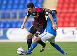 St Johnstone v Inverness Caledonian Thistle...05.10.13      SPFL<br /> Ross Draper is tackled by Nigel Hasselbaink<br /> Picture by Graeme Hart.<br /> Copyright Perthshire Picture Agency<br /> Tel: 01738 623350  Mobile: 07990 594431