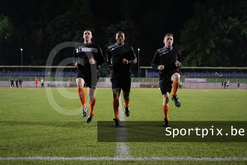 Referee Tanko Frank (M) and assistants Renard Jordan (L) and Cedric Abrassart (R) pictured during a female soccer game between FC Femina White Star Woluwe and Eendracht Aalst on the sixth matchday in the 2021 - 2022 season of Belgian Scooore Womens Super League , friday 8 th of october 2021  in Woluwe , Belgium . PHOTO SPORTPIX | KRISTOF DE MOOR