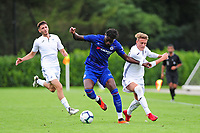 Dynel Simeu of Chelsea FC battles with Bradley GIbbings of Swansea City during the Premier League u18 match between Swansea City AFC and Chelsea FC at Landore Training Ground, Wales, UK. Tuesday 11th September 2018