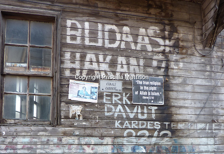 """Istanbul, Turkey - September 23, 2009:  A poster on the side of a building reads, """"The true religion in the sight of Allah is Islam""""."""