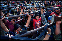 A Maoist rebel soldier wearing a Britney Spears t-shirt stands among a batallion of other soldiers of the People's Liberation Army, First Brigade, Mid Division during a drill in a schoolyard in the village of Gairigaon, Nepal on Wednesday, 16 February 2005.<br />
