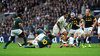 Billy Vunipola of England is tackled by Pat Lambie of South Africa during the QBE International match between England and South Africa at Twickenham Stadium on Saturday 15th November 2014 (Photo by Rob Munro)