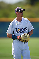 GCL Rays Russ Olive (24) warms up in the outfield between innings during a game against the GCL Twins on August 9, 2018 at Charlotte Sports Park in Port Charlotte, Florida.  GCL Twins defeated GCL Rays 5-2.  (Mike Janes/Four Seam Images)