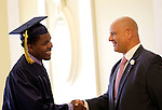 Waterbury, CT- 13 June 2016-061316CM02-Enlightenment School graduate Darnell Lammie, left, is welcomed by principal Richard Arroyo during the Enlightenment Program at City Hall in Waterbury on Monday.      Christopher Massa Republican-American