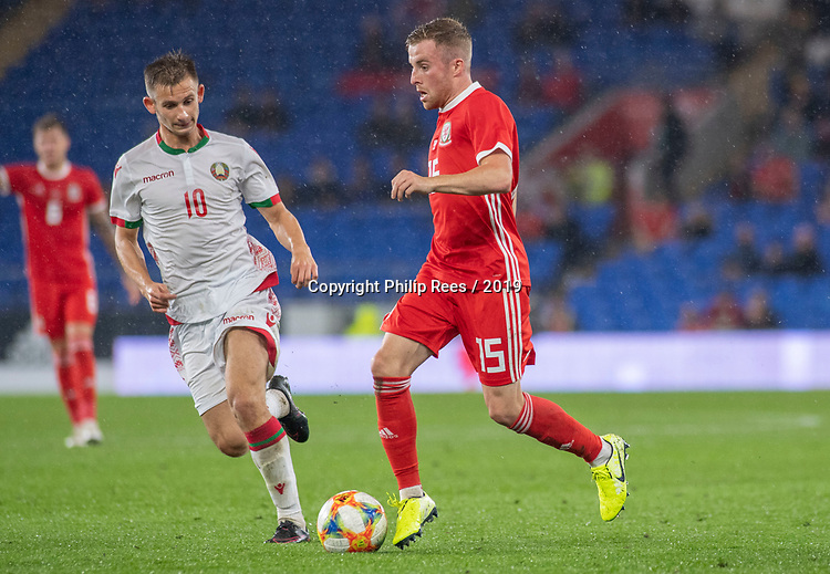 Cardiff - UK - 9th September :<br />Wales v Belarus Friendly match at Cardiff City Stadium.<br />Joe Morrell of Wales is marked by Ivan Bakhar of Belarus.<br />Editorial use only