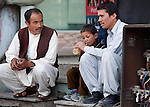 11 April 2013, Islamabad, Pakistan:  Ghulam Ali (right) with his nephew Mohmmad Asif (6) and Mohammad Ali at a juice stall in Islamabad, Pakistan.    Ghulam's brother, and Asif's father, Khadim Hussain (28) and Mohammad's brother, Safar Mohammad (25) were both aboard a people smuggling boat full of Hazara's fleeing sectarian violence that sank off Indonesia in April 2012.  Two bodies from the accident remain to be identified in Australia and the men travelled from their home in Quetta, Pakistan to submit DNA samples to Australian authorities in the hope of identifying their loved ones. Picture by Graham Crouch/The Australian