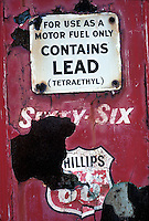 Old peeling painted gasoline advertisment<br />