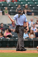 Home plate umpire Travis Eggert during a game between the San Antonio Missions and Arkansas Travelers on May 24, 2014 at Dickey-Stephens Park in Little Rock, Arkansas.  (Mike Janes/Four Seam Images)