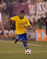 Brazil defender Andre Santos (6) dribbles down the wing. Brazil  defeated the US men's national team, 2-0, in a friendly at Meadowlands Stadium on August 10, 2010.
