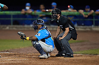 Myrtle Beach Pelicans catcher Pablo Aliendo (4) sets a target as home plate umpire Mike Mackey looks on during the game against the Lynchburg Hillcats at Bank of the James Stadium on May 22, 2021 in Lynchburg, Virginia. (Brian Westerholt/Four Seam Images)
