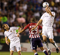 LA Galaxy defender Omar Gonzalez had a stellar evening as he clears a ball using his head. The LA Galaxy defeated Chivas USA 1-0 to win the final edition of the 2009 SuperClásico at Home Depot Center stadium in Carson, California on Saturday, August 29, 2009...