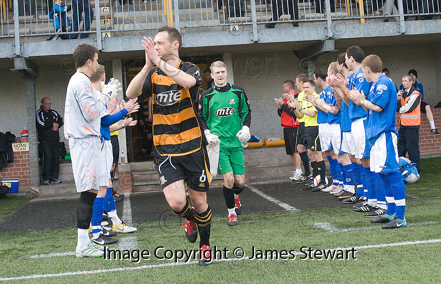 Third division champions Alloa are applauded on to the park by opponents Stranraer.