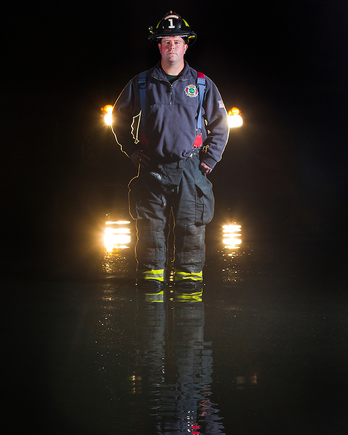 Sean Price was part of a team of Manasquan lifeguards and firefighters that rescued dozens of trapped residents at the height of Hurricane Sandy. A news photo of Price, making his way through chest deep water in total darkness searching for victims, went viral as the historic storm slammed the Jersey Shore.  He is photographed a year later, on the same flooded street.