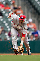 Houston Cougars third baseman Justin Montemayor #20 makes an error during the NCAA baseball game against the Texas Longhorns on March 1, 2014 during the Houston College Classic at Minute Maid Park in Houston, Texas. The Longhorns defeated the Cougars 3-2. (Andrew Woolley/Four Seam Images)