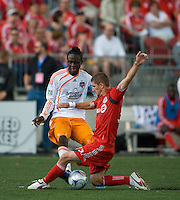 18 July 2009: Houston Dynamo forward Kei Kamara #10 and Toronto FC midfielder Carl Robinson #33 battle hard for a ball during a game between the Toronto FC and Houston Dynamo..The game ended in a 1-1 draw..