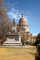 """Vintage view of the monument to the Confederate soldiers: """"Five bronze figures on a gray granite base represent the Infantry, Cavalry, Artillery, and Navy, headed by the Confederate president, Jefferson Davis."""" 1948 - Stock Image. The Confederate Soldiers Monument is located on the historic south grounds of the Texas State Capitol, near the Congress Avenue entrance gates. Construction of the monument begain in 1900 and was completed in 1903. It consists of bronze figures representing infantry, cavalry, Confederate states, and battles fought between 1861 and 1865."""