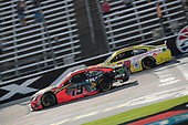 Martin Truex Jr. (19) races for the O'Reilly Auto Parts 500 at Texas Motor Speedway in Fort Worth, Texas.