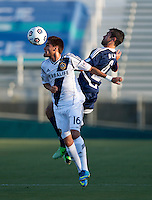 Austin Da Luz (6) of the Carolina Railhawks goes up for a header with Hector Jimenez (16) of the LA Galaxy during a third round match in the US Open Cup at WakeMed Soccer Park in Cary, NC.  The Carolina Railhawks defeated the LA Galaxy, 2-0.