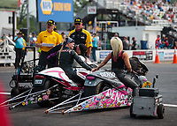 Aug 18, 2018; Brainerd, MN, USA; NHRA pro stock motorcycle rider Angie Smith (right) holds hands with Kelly Clontz during qualifying for the Lucas Oil Nationals at Brainerd International Raceway. Mandatory Credit: Mark J. Rebilas-USA TODAY Sports