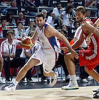Aleksandar RASIC (Serbia)  passes Semih ERDEN (Turkey) during the semi-final World championship basketball match against Turkey in Istanbul, Serbia-Turkey, Turkey on Saturday, Sep. 11, 2010. (Novak Djurovic/Starsportphoto.com) .