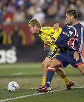 Brandon Moss (Columbus Crew, yellow) holds off Clint Dempsey (NE Revolution, blue). NE Revolution defeat Columbus Crew, 1-0, at Gillette Stadium and secure home field advantage in the Eastern Conference Semifinal Series on October 14, 2006.