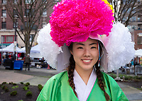 Beautiful asian girl wearing Korean traditonal outfit, Chinese New Year Celebration, Chinatown, Seattle, WA, USA.