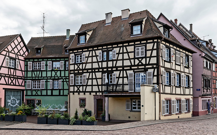 A street corner with colorful half-timbered houses in Colmar