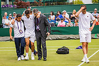 London, England, 8 July, 2019, Tennis,  Wimbledon, Men's doubles: Drama for the team Gonzalez/Zeballos, (ARG) a hamstring injury prevents them to finish in the fifth set against  Jean-Julian Rojer (NED) and Horia Tecau (ROU)<br /> Photo: Henk Koster/tennisimages.com