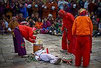 Clowns provide comic relief , Bhumthang festival, Jakar, Bhutan