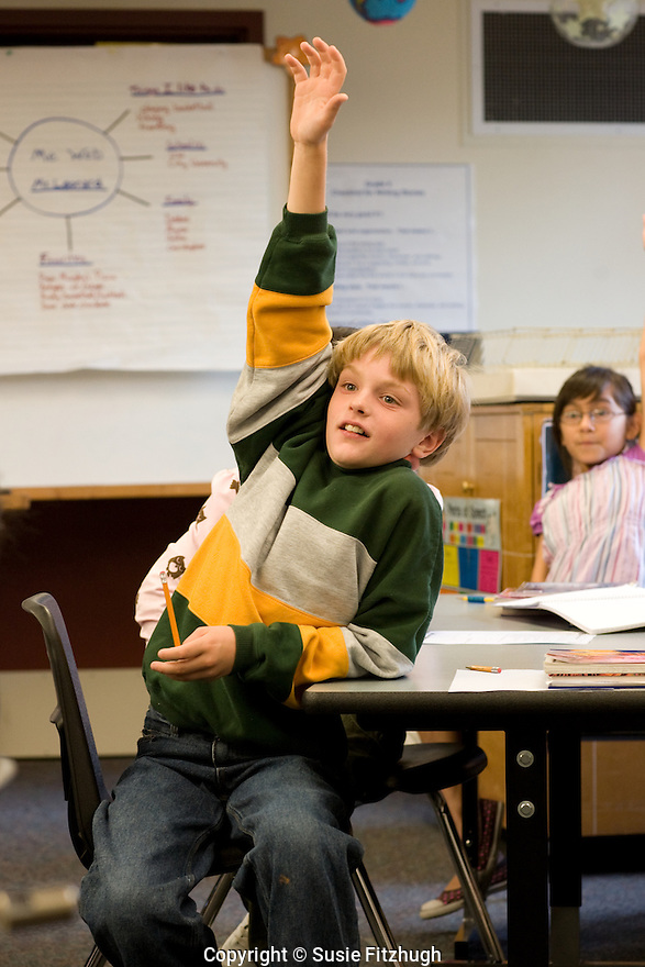 An unexpected oral math quiz is met with great enthusiasm by the 5th graders.