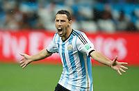 Maxi Rodriguez of Argentina celebrates scoring the winning penalty