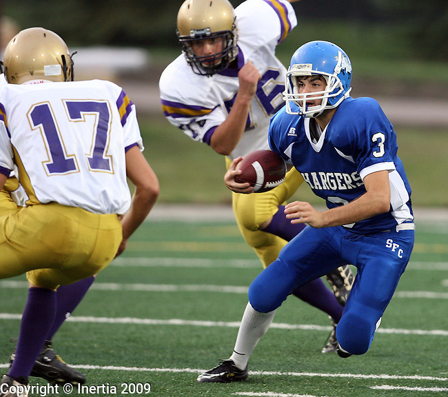 SIOUX FALLS, SD - SEPTEMBER 11:  Taylor Thompson #3 of Sioux Falls Christian looks to make a move past Joe Parsley #17 of Flandreau in the first quarter of the Chargers home opener at the USF Athletic Complex. (Photo by Dave Eggen/Inertia).