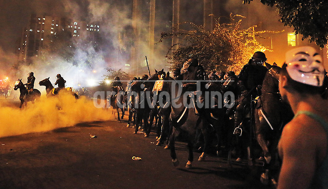 Mounted Police move towards demonstrators during the riot on the streets of Rio, in front of the City Hall, Rio de Janeiro, Brazil, June 20, 2013. The people of this movement protest against official corruption and spending on next year's World Cup. (Austral Foto/Léo Corrêa)