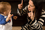 toddler boy 18 months old with mother interaction language development holding up fingers horizontal