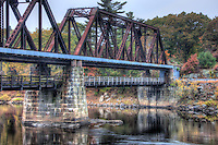 The historic Free Black Bridge, a through truss pin-connected bridge, spans the Androscoggin River on the Maine Central Railroad in Brunswick, Maine