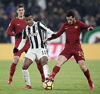 Calcio, Serie A: Juventus - AS Roma, Torino, Allianz Stadium, 23 dicembre, 2017. <br /> Roma's Alessandro Florenzi (r) in action with Juventus Alex Sandro (l) during the Italian Serie A football match between Juventus and Roma at Torino's Allianz stadium, December 23, 2017.<br /> UPDATE IMAGES PRESS/Isabella Bonotto