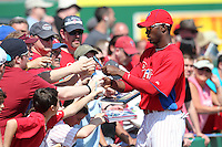 Philadelphia Phillies Domonic Brown #9 signs autographs before a scrimmage vs the Florida State Seminoles  at Bright House Field in Clearwater, Florida;  February 24, 2011.  Philadelphia defeated Florida State 8-0.  Photo By Mike Janes/Four Seam Images