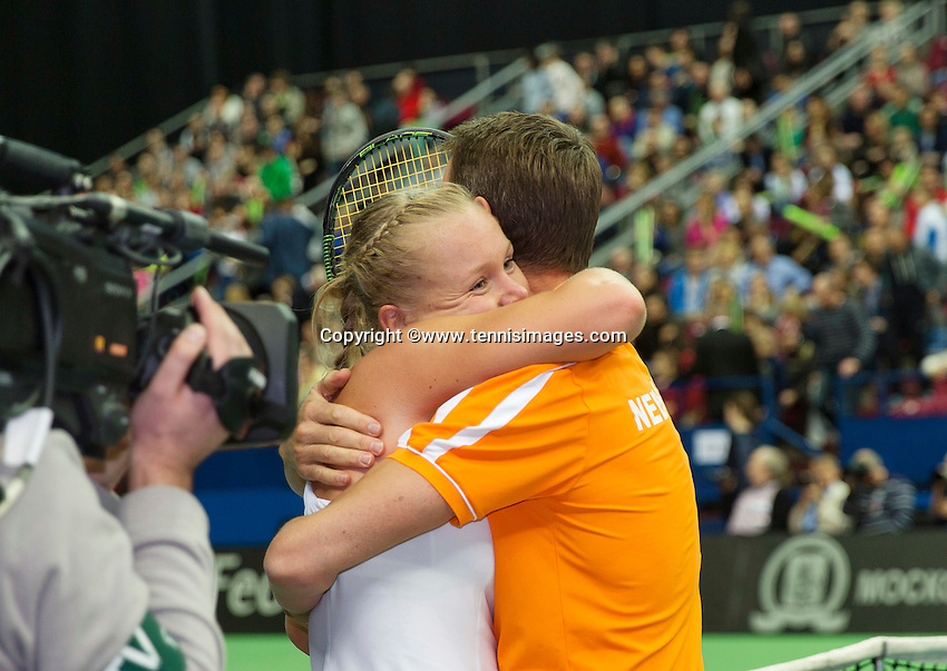 Moskou, Russia, Februari 7, 2016,  Fed Cup Russia-Netherlands, Kiki Bertens (NED) jumps in the arms of captain Paul Haarhuis after making the winning point against Russia<br /> Photo: Tennisimages/Henk Koster