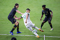 LOS ANGELES, CA - SEPTEMBER 13: Felipe Mora #9 of the Portland Timbers attempts to dribble through Dejan Jakovic #5 and Latif Blessing #7 of LAFC during a game between Portland Timbers and Los Angeles FC at Banc of California stadium on September 13, 2020 in Los Angeles, California.