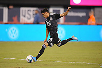 EAST RUTHERFORD, NJ - SEPTEMBER 7: Uriel Antuna #26 of Mexico kicks the ball during a game between Mexico and USMNT at MetLife Stadium on September 6, 2019 in East Rutherford, New Jersey.