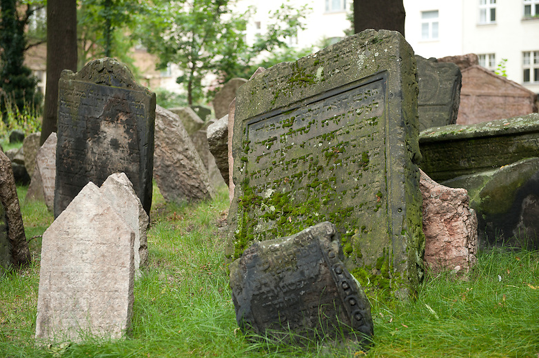 It was impossible to purchase extra land for the cemetery therefore the cemetery ran out of space.  The solution to this was to place soil on top of the existing graves and move the tombstones up to the next level. It is believed that some parts of the cemetery are up to 12 layers deep..