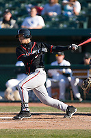 A.J. Jimenez #6 of the Lansing Lugnuts follows through on his swing versus the South Bend Silver Hawks at Coveleski Stadium April 15, 2009 in South Bend, Indiana. (Photo by Brian Westerholt / Four Seam Images)